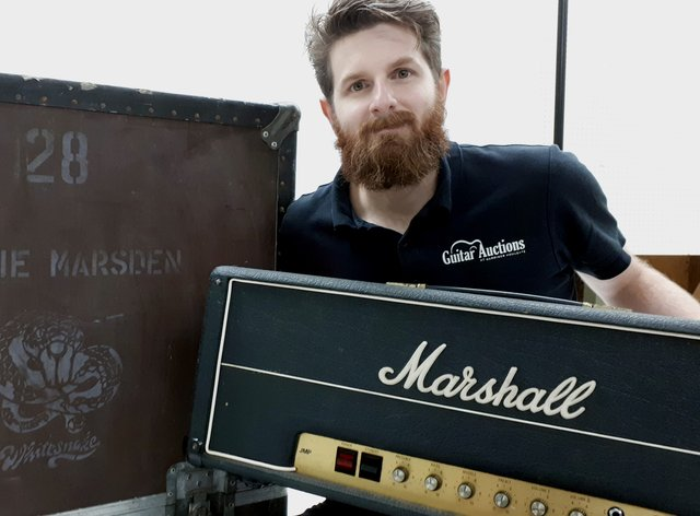 An auctioneer with a Marshall amp