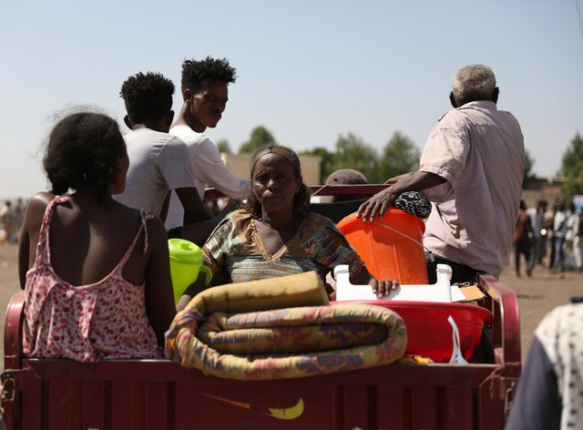 Refugees from the Tigray region of Ethiopia arrive to register at the UNHCR centre at Hamdayet, Sudan
