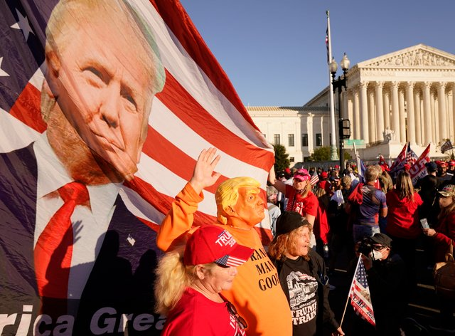 Supporters of US president Donald Trump march outside the Supreme Court building in Washington