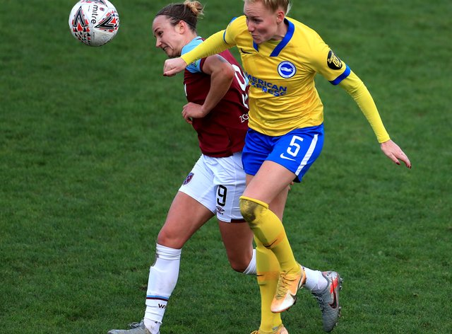West Ham's Martha Thomas (left) and Brighton's Danique Kerkdijk battle for the ball during Brighton's 1-0 win in the Women's Super League.
