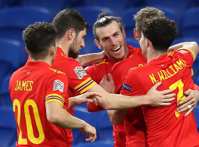 Gareth Bale (centre) and team-mates celebrate David Brooks' goal against the Republic of Ireland in Cardiff