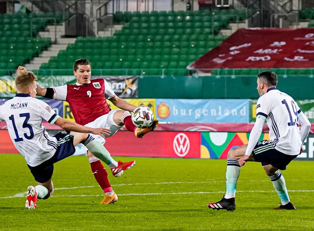 Ali McCann, left, made his Northern Ireland debut in the Austria defeat