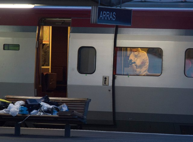 A police officer videos the crime scene inside a Thalys train at Arras train station, northern France, in 2015