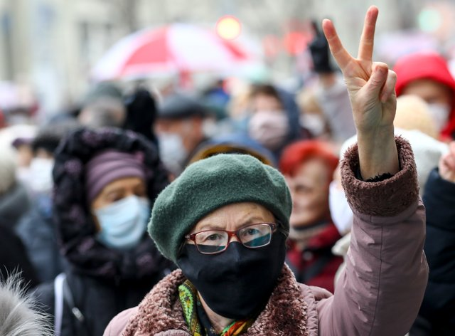 A woman gestures as she attends a pensioners' opposition rally in Minsk