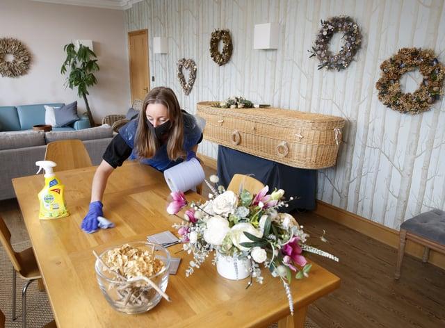 Funeral director Sarah Jones wears PPE