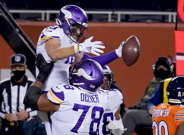 <p>Minnesota Vikings wide receiver Adam Thielen is congratulated by teammate Dakota Dozier (78) after catching a touchdown pass during the second half against the Chicago Bears</p>
