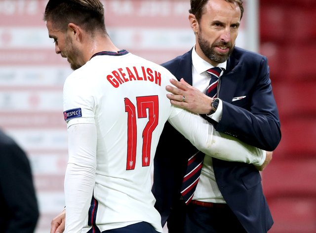 England manager Gareth Southgate, right, embraces Jack Grealish