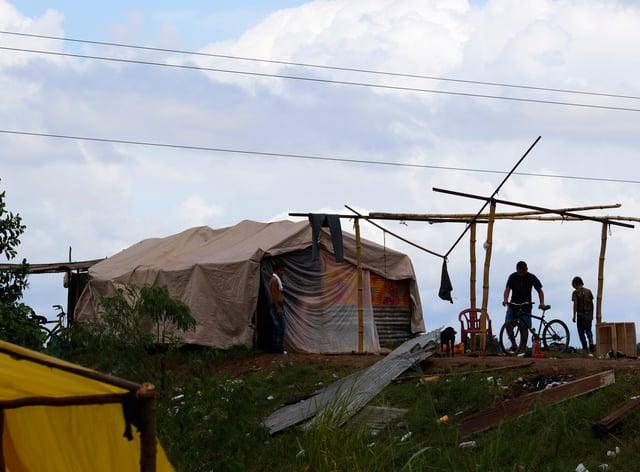 People living under precarious conditions make preparations before Hurricane Iota makes landfall in San Manuel Cortes, Honduras