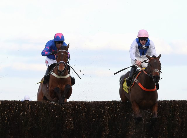 Waiting Patiently and Brian Hughes (right) lead Cue Card and Paddy Brennan away from the last fence before going on to win the 2018 Betfair Ascot Steeple Chase