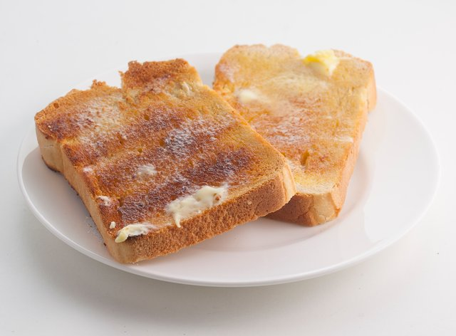Buttered toast on plate