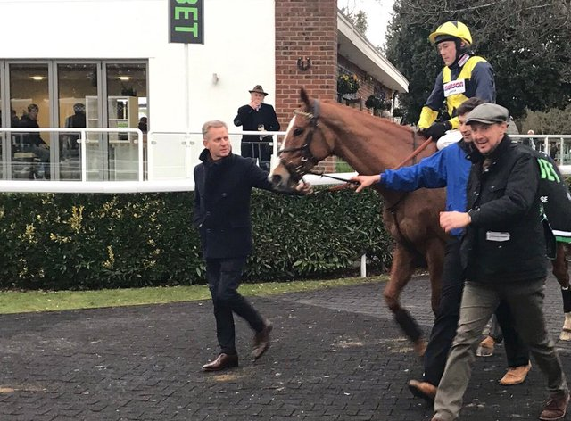 Jeremy Kyle walks in with Glen Rocco following victory at Kempton