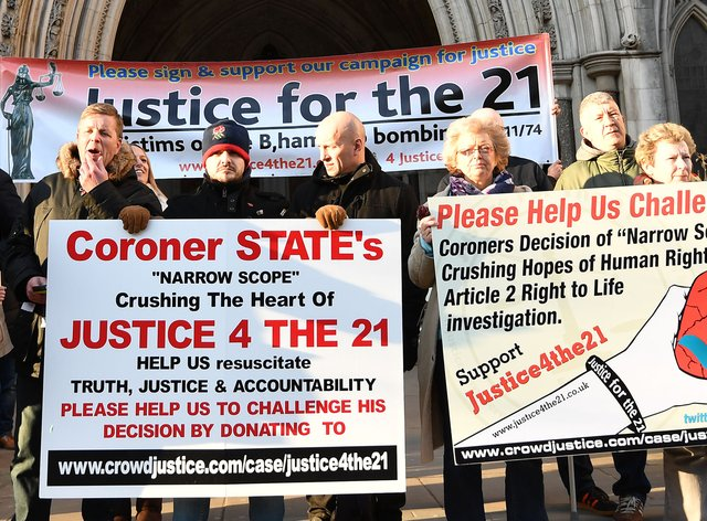 Protesters outside the High Court in London demanding justice for the 21 victims of the Birmingham pub bombings