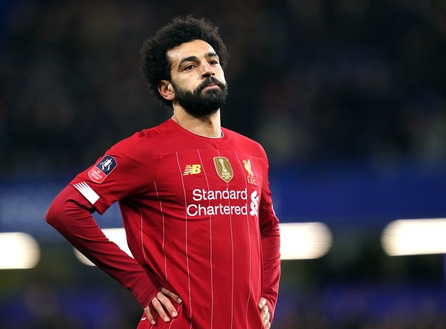 Liverpool forward Mohamed Salah is said to be showing only mild symptoms