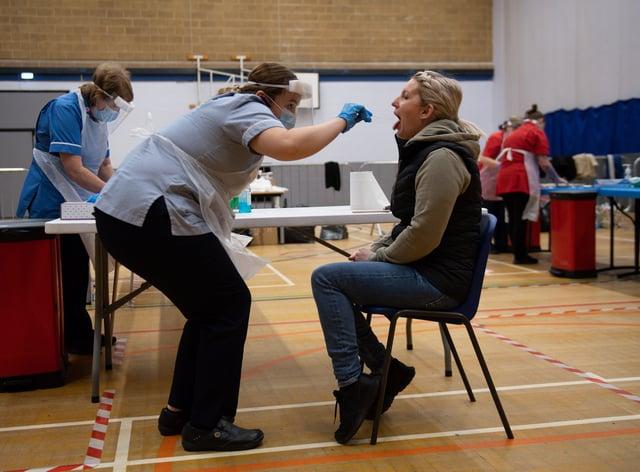 A nurse administers a Covid-19 test