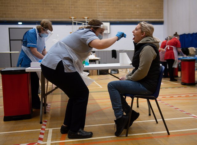 A nurse administers a test at Dimensions Leisure Centre in Stoke-on-Trent (Jacob King/PA)