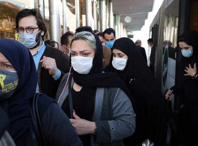 People wear protective face masks to help prevent the spread of coronavirus in Tehran, Iran