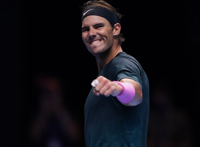 Rafael Nadal celebrates beating Stefanos Tsitsipas