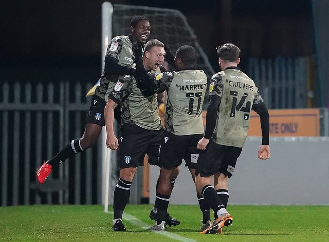 Luke Norris, second left, grabbed a late equalised for Colchester