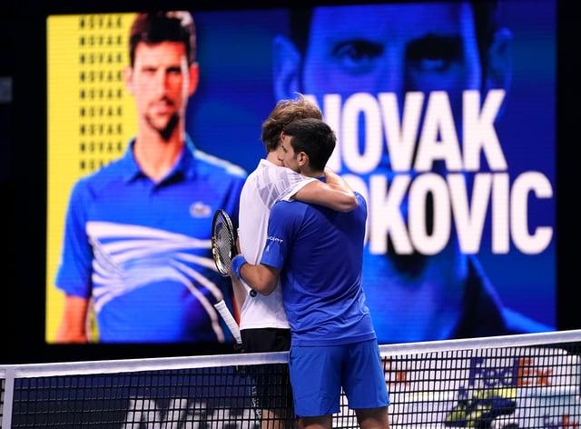 Novak Djokovic (right) embraces Alexander Zverev after their match at The O2