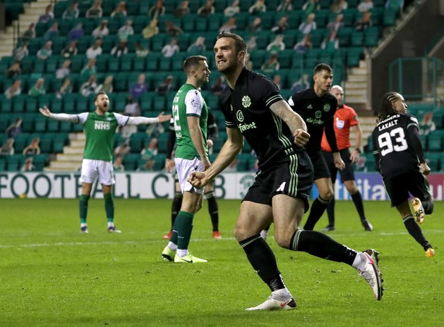 Shane Duffy celebrates Celtic's leveller scored by Diego Laxalt, background, at Hibs