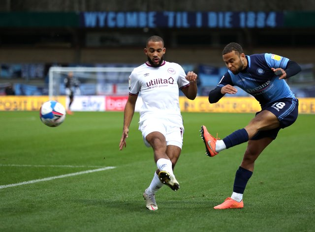 Brentford's Bryan Mbeumo (left) was unable to find a way past the Wycombe defence