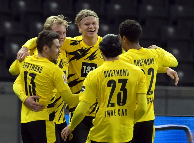 Erling Braut Haaland (centre) scored four goal as Borussia Dortmund thrashed Hertha Berlin