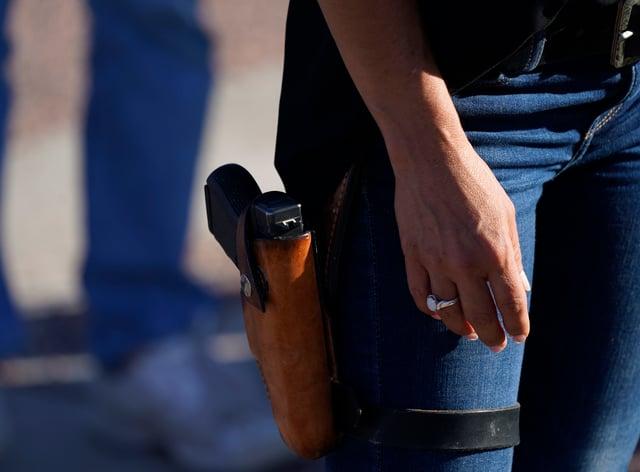 Lauren Boebert, the Republican candidate, with a gun in her holster (David Zalubowski/AP)