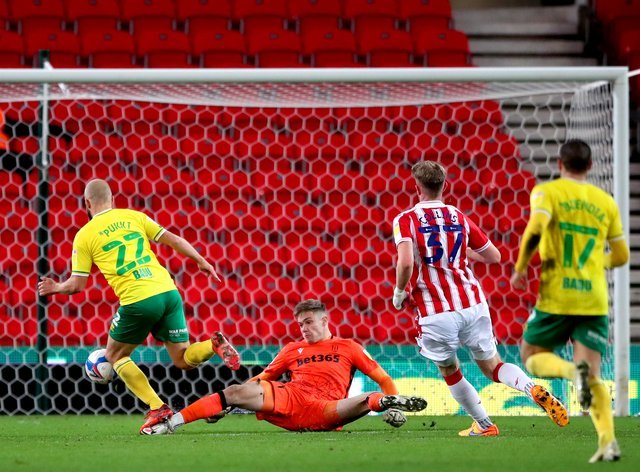 Norwich striker Teemu Pukki, left, nets his second of the game in the win at Stoke