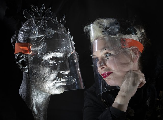 Boo Paterson with two of her bespoke fashion face shields