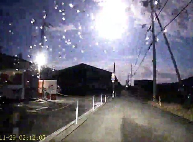 A brightly burning meteor over Japan