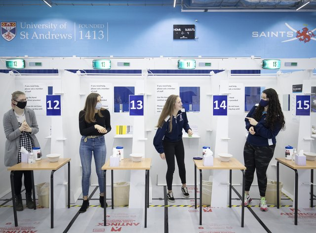 Students get a Covid-19 test at a mass testing centre set up at the sports centre at St Andrews University, ahead of the Christmas holiday