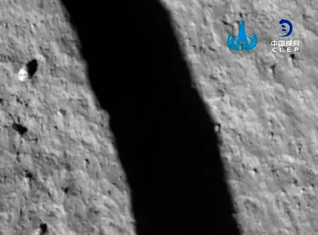 The spacecraft's shadow is reflected on the surface of the moon during its landing process (Chinese National Space Administration/AP)