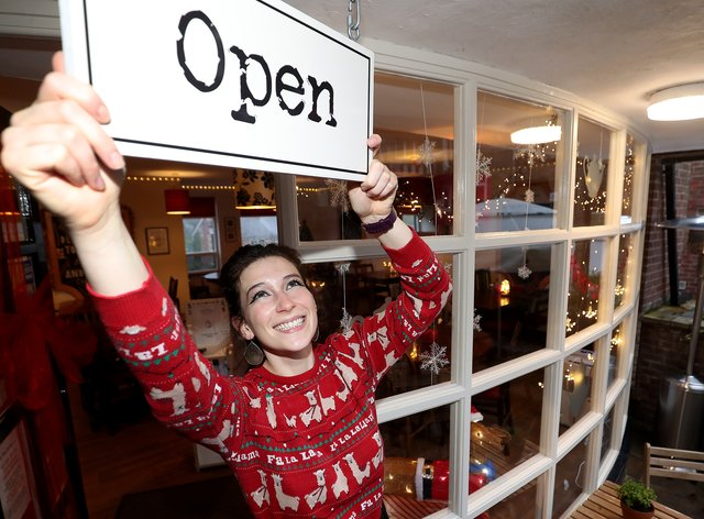 Coffee shop owner hangs 'open' sign