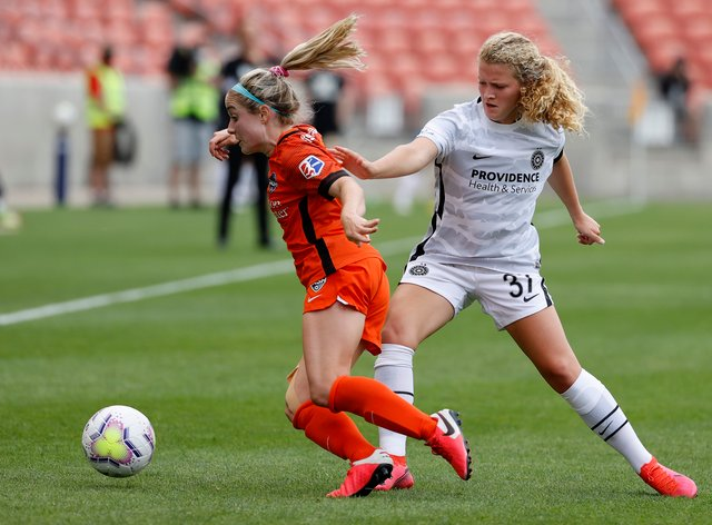 <p>Ogle, right, has moved to Dash from Thorns</p>