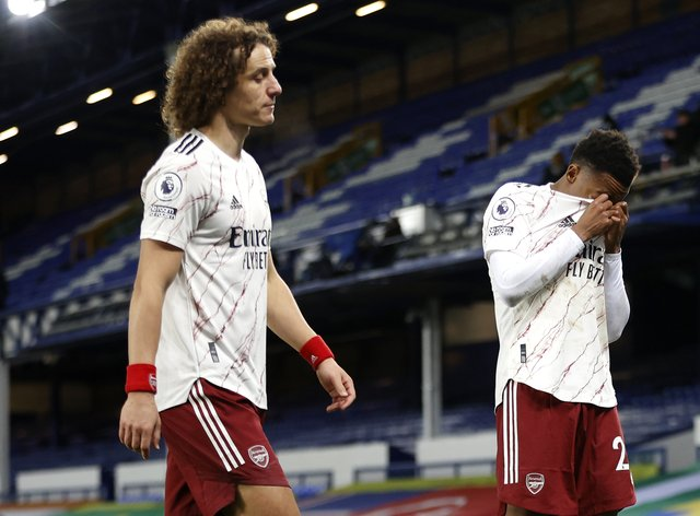 David Luiz (left) and Joe Willock appear dejected at Goodison Park