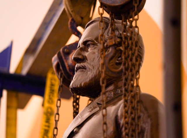 A statue of Confederate General Robert E Lee being removed from the National Statuary Hall Collection in Washington