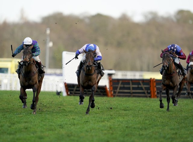 Thyme Hill (left) leads over the last from Roksana and eventual winner Paisley Park (right)