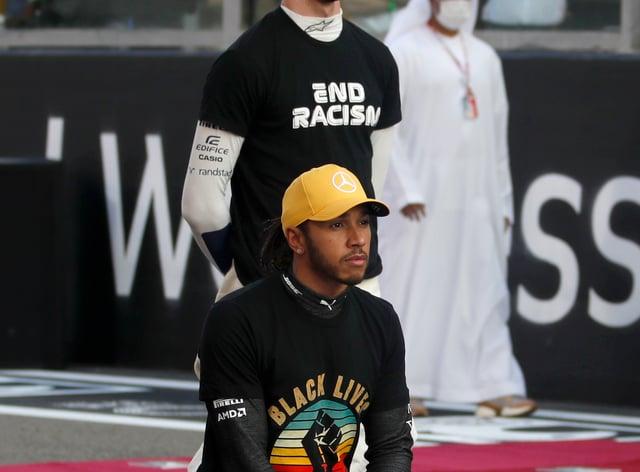 Lewis Hamilton takes a knee