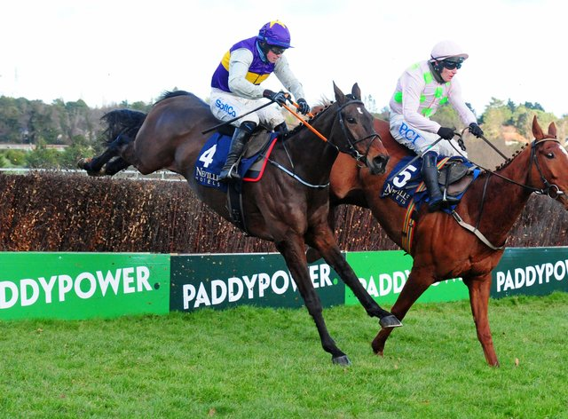 Monkfish and Paul Townend (right) get the better of their tussle with Latest Exhibition in the Neville Hotels Novice Chase at Leopardstown