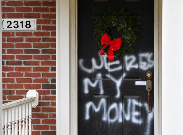 <p>Graffiti at the home of Senate majority leader Mitch McConnell in Louisville, Kentucky (Timothy D Easley/AP)</p>