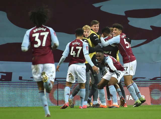 Aston Villa celebrate Louie Barry's equalising goal against Liverpool.