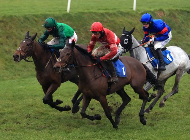 Zambella and Daryl Jacob (left, green) on their way to winning the Pertemps Network Mares' Chase at Leicester Racecourse