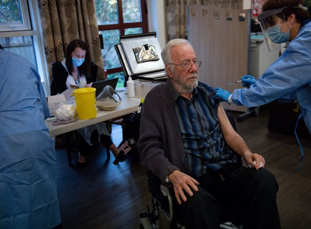Care home resident Michael Starr getting his jab