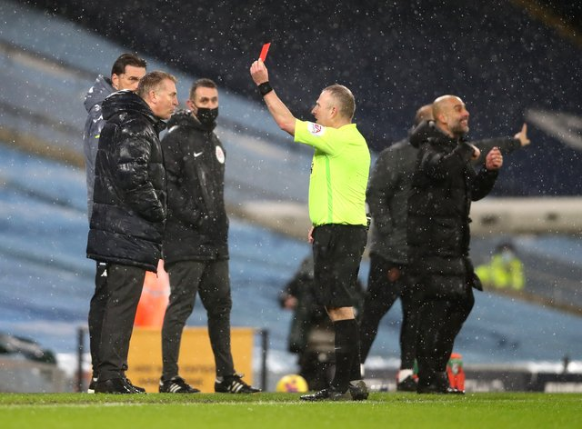 Dean Smith (left) was sent off by referee Jon Moss