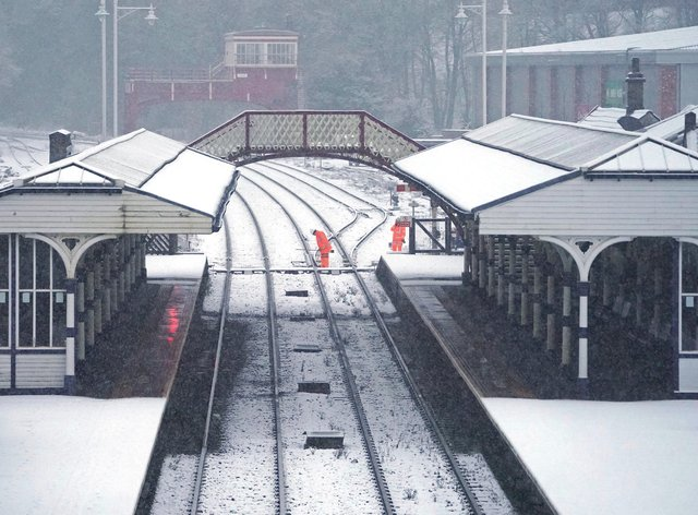 Rail workers checking the points at Hexham train station, Northumberland
