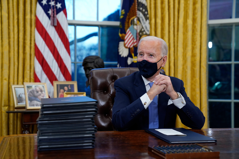 President Biden targets Trump policies as he starts work