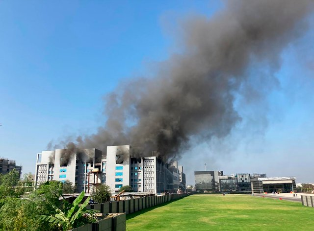 Smoke rises from the Serum Institute of India, the world's largest vaccine maker that is manufacturing the AstraZeneca/Oxford University vaccine in Pune, India