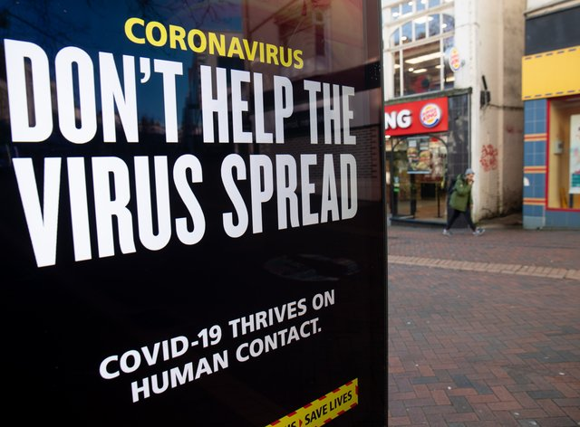 A 'Don't help the virus spread' government coronavirus sign during England's third national lockdown