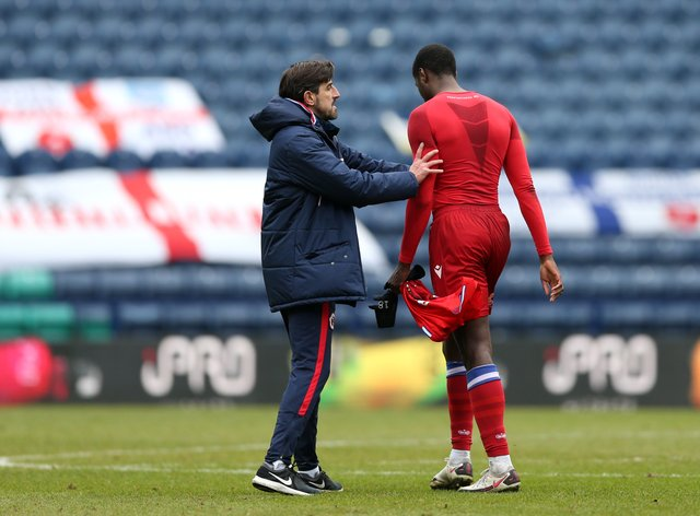 Reading's Lucas Joao (right) is consoled by manager Veljko Paunovic