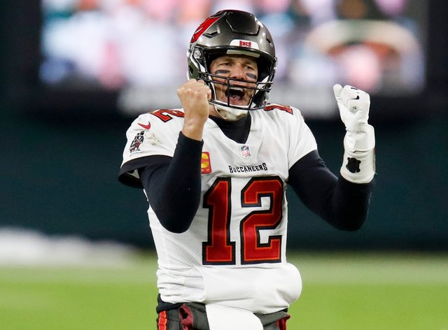 Tampa Bay Buccaneers quarterback Tom Brady reacts after winning the NFC championship game against the Green Bay Packers
